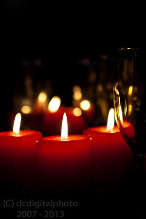 Red candles and wine glasses